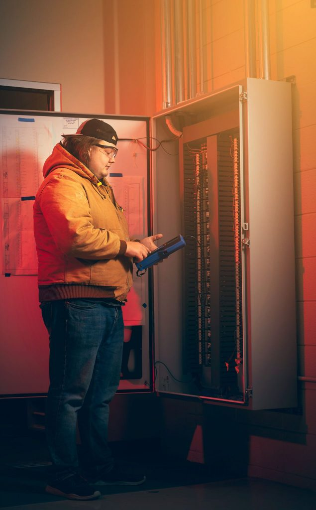 A student examines a switch board at a community college in Mississippi